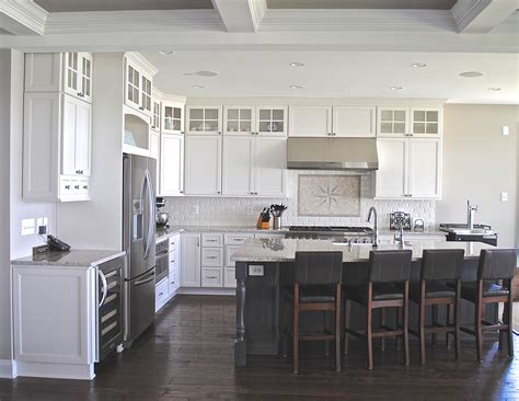 white cabinets gray island coastal white kitchen with dark grey island cabinets