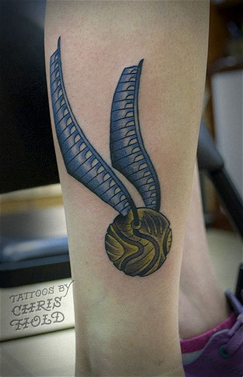 golden snitch tattoo quidditch the golden snitch from harry potter