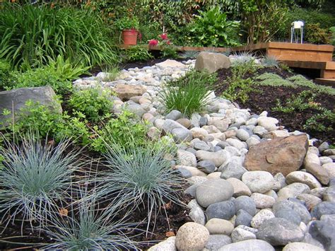 river rock garden bed creek garden asian landscape vancouver by garden culture