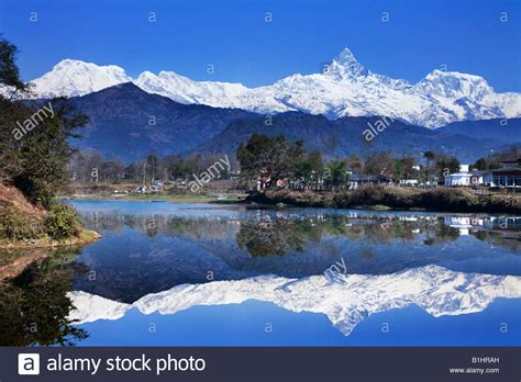buy house in pokhara nepal reflection of mountains in a lake fewa lake pokhara nepal stock photo royalty free