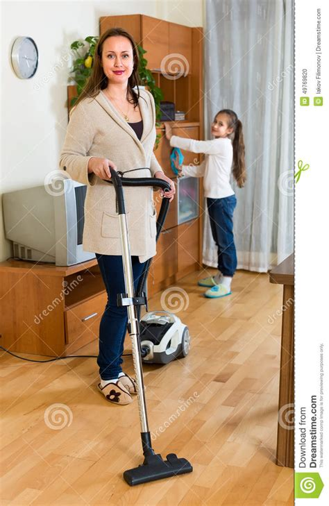 In Law Apartment House Plans girl helping mom to clean furniture stock photo image