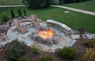 Overhead view of oval flagstone patio with large fire pit created with