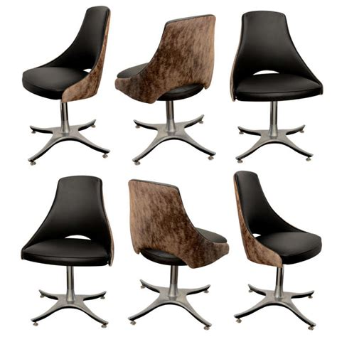 six leather and hide swivel dining chairs at 1stdibs