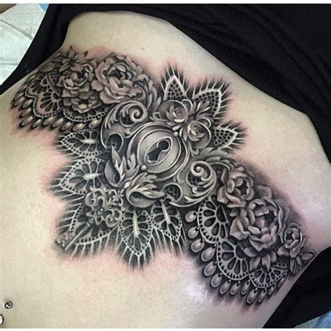 black and grey sternum tattoo by ryan ashley malarkey