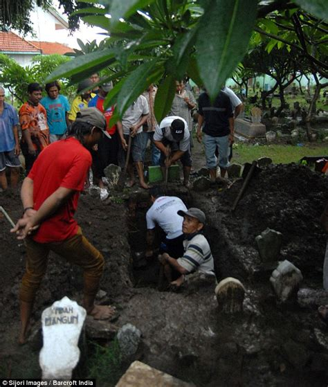 airasia victims first airasia victim is buried as officials vow all out