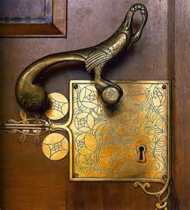 antique brass door hardware content in a cottage