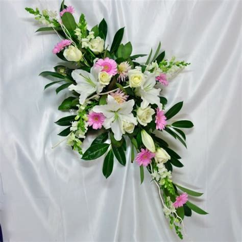 natural flower cross for funeral floral arrangement