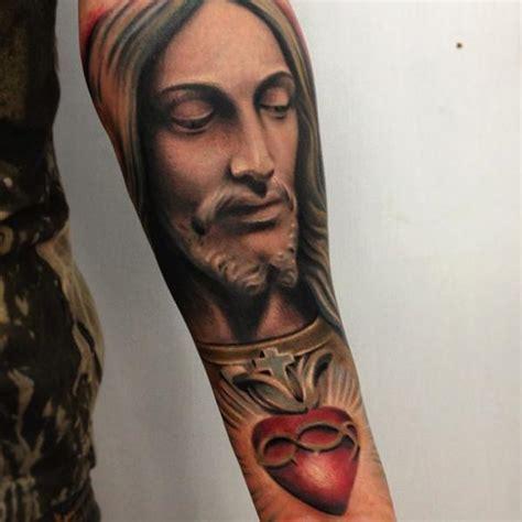 jesus tattoo underarm arm religious tattoo by yomico art