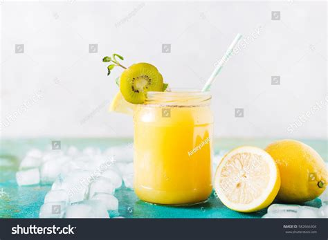 Orange Juice Detox Smoothie by Orange Juice Orange Smoothie On Turquoise Stock Photo