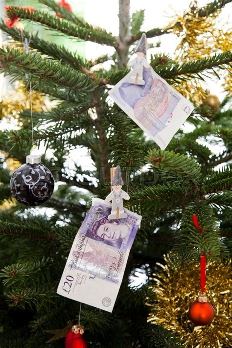 which british monache introduced the christmas tree to uk tree with hanging money pound decoration stock photo colourbox