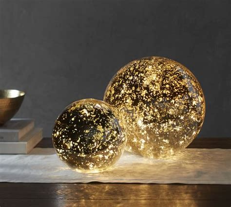 Pottery Barn Globe Lights lit mercury glass globe pottery barn