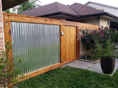 wood and metal fence sawn cedar galvanized corrugated metal fence