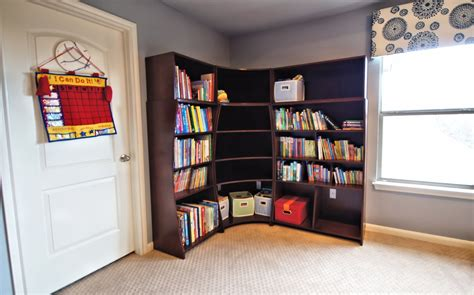 large corner bookcase by the window for room
