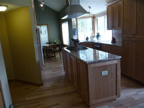vaulted kitchen with hickory floors cherry cabinets