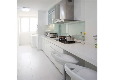 backsplash for kitchen singapore glass backsplash and white cabinets help to brighten this kitchen design by plush living