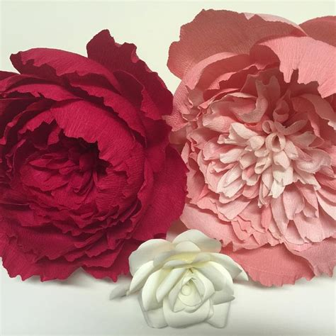 large crepe paper flowers and a paper pink