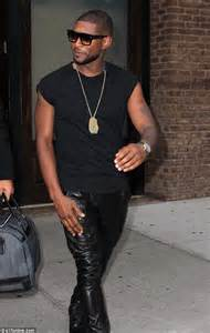 usher shows off sculpted arms in short sleeve top as he