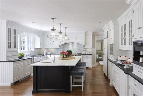 white kitchens with islands white cabinets with black island transitional kitchen