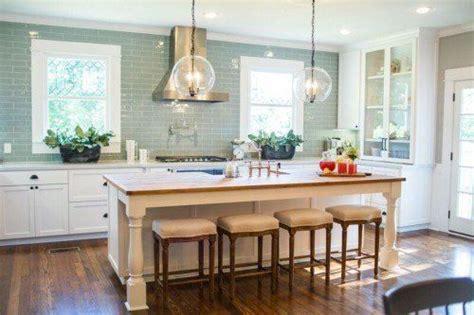 kitchen  upper cabinets sink  island stove     hood windows
