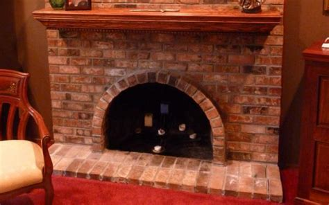need advice turning arched fireplace opening to