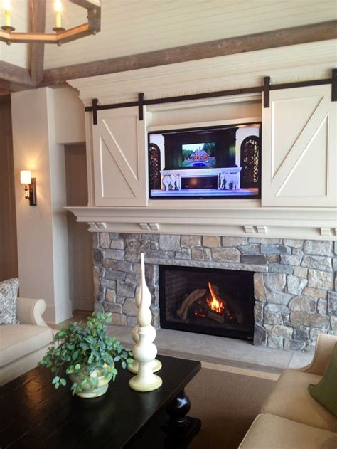 tv cabinet with sliding doors to hide tv barn door for the tv super cute would be cool to put a