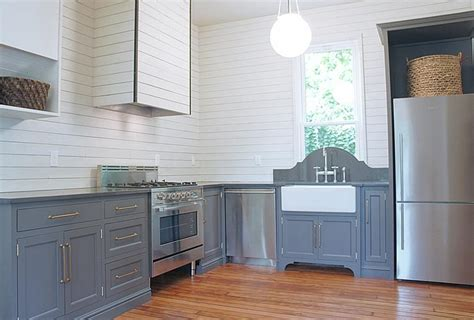 Pot Filler Kitchen Faucet white shiplap kitchen cabinets with aged brass oval knobs
