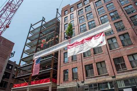 affordable housing boston consigli tops off residential development in boston s chinatown consigli