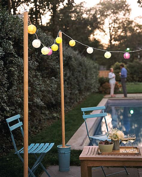 what to use to hang lights outside outdoor lighting ideas martha stewart