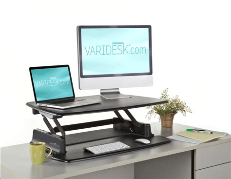 standing up at your desk stand up desks choose the varidesk