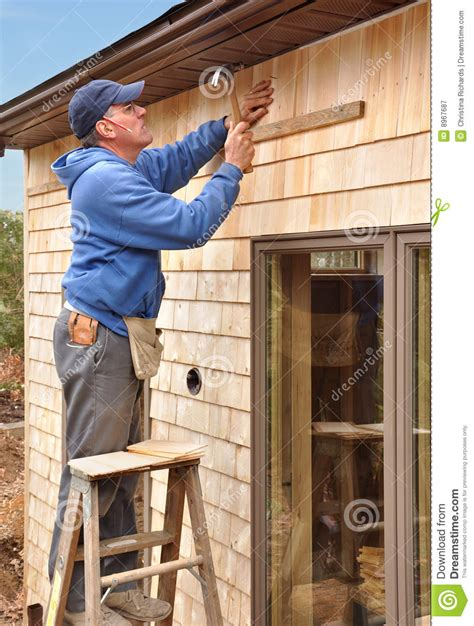Cedar Shingles Prices Carpenter Installing Cedar Shingles Royalty Free Stock