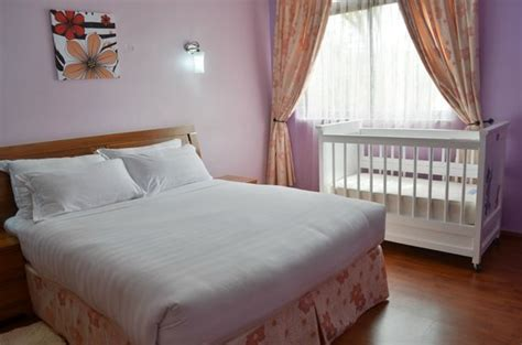 one bedroom apartment with baby bed rooms with baby crib picture of fahari palace
