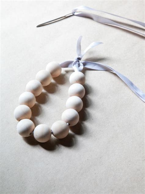 how to make a wooden bead ornament hgtv