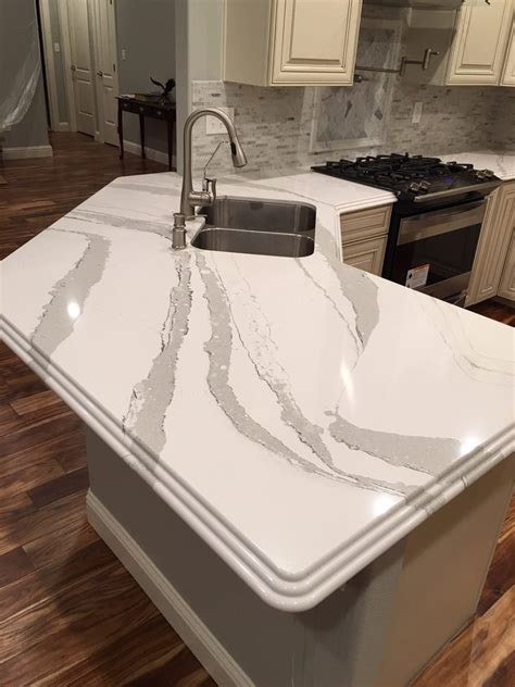 Fabricated Countertops by Timberlake Kitchen Cabinets And Cambria Brittanica Quartz