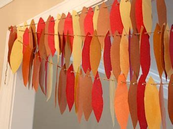 How To Make Feathers Out Of Construction Paper - turkey feather garland craft ideas for