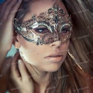 what to wear for halloween with a masquerade mask black venetian style metal mask filigree masquerade party