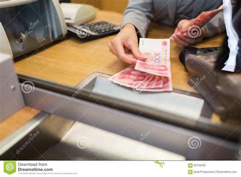 bank clerk bank clerk opening safe deposit box vector