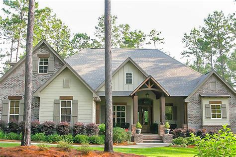 craftsman home plans with pictures craftsman house plan with rustic exterior and bonus above