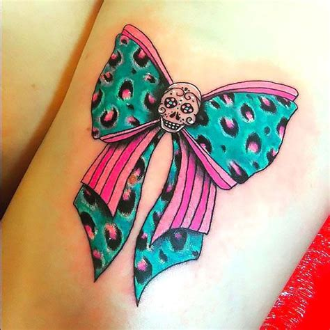 green leopard bow tattoo idea