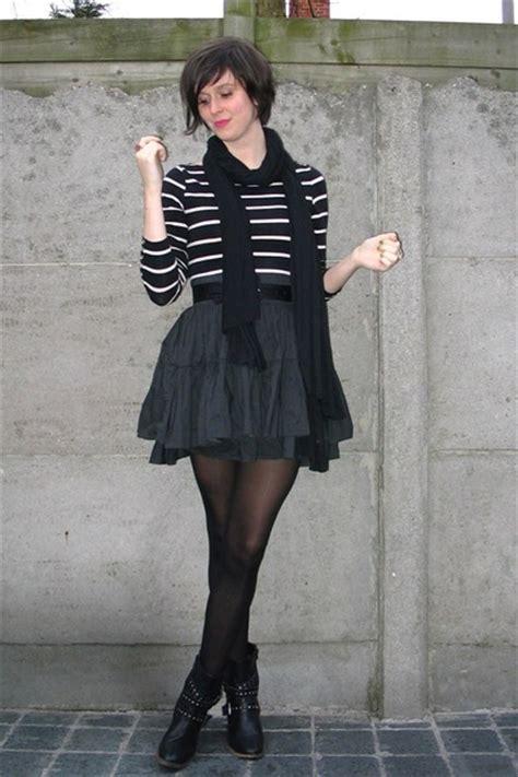black tops black skirts black boots black scarves