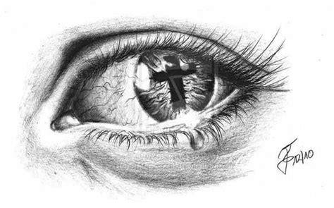 cross tattoo under eye cross in eye design