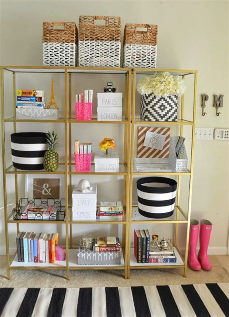 white and gold bookcase home entryway gold shelves black white baskets