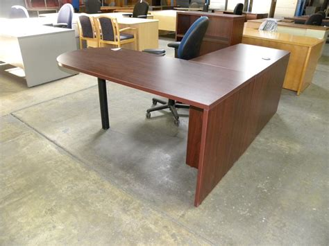 used l shape laminate desk with peninsula bullet front