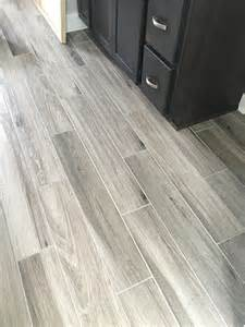 flooring ideas for bathrooms newly installed gray weathered wood plank tile flooring
