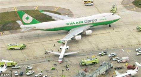 narrow escape for tiny commuter plane as 747 jumbo jet its on the runway and flips