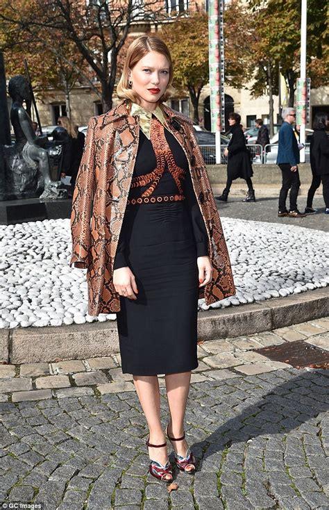 lea seydoux bond dress bond girl l 233 a seydoux wears orange snakeskin coat over