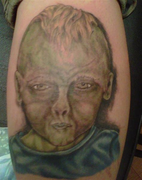 tattoos are ugly kid portrait bad tattoos regrettable terrible