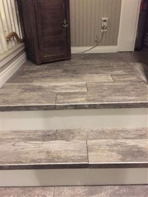 wood plank tile on staircase with white painted railings ideas we have new stair railing stair railing blog and basements