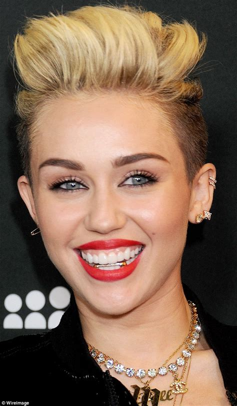 miley cyrus continues her gangsta transformation with a