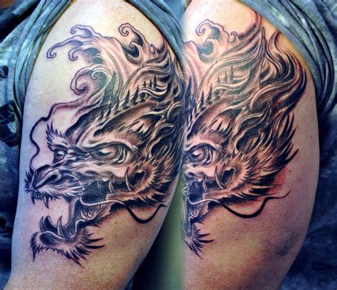 dragon head tattoo by gettattoo on deviantart