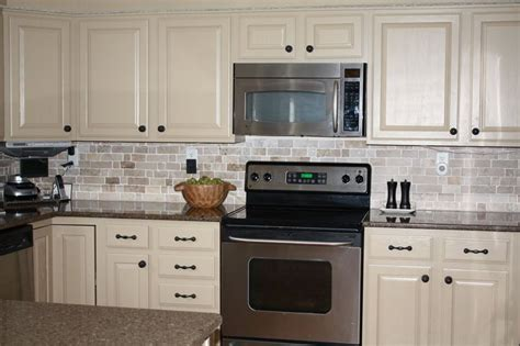 cream painted kitchen cabinets love the cream color painted kitchen cabinets with dark